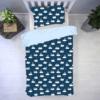 śpiące zajączki z błękitnym z tłem